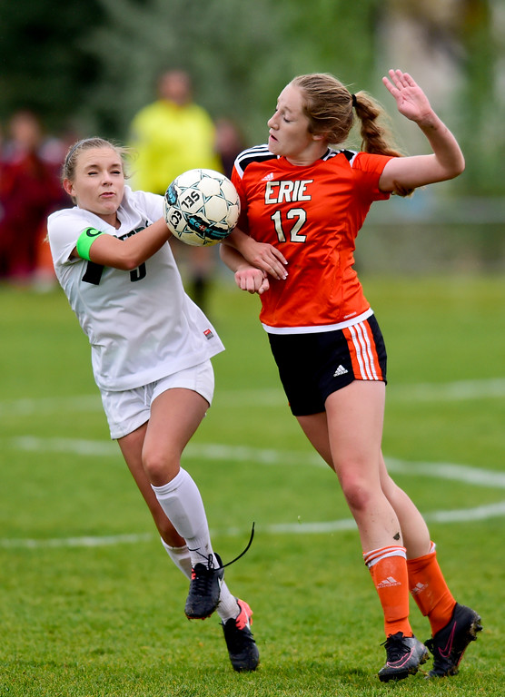 . Niwot High School\'s Lauren Wolf (No. 5) and Erie High School\'s Dana Johnson (No. 12) collide while trying to gain control of the ball on Wednesday. More photos: BoCoPreps.com. Matthew Jonas/Staff Photographer May 10, 2017