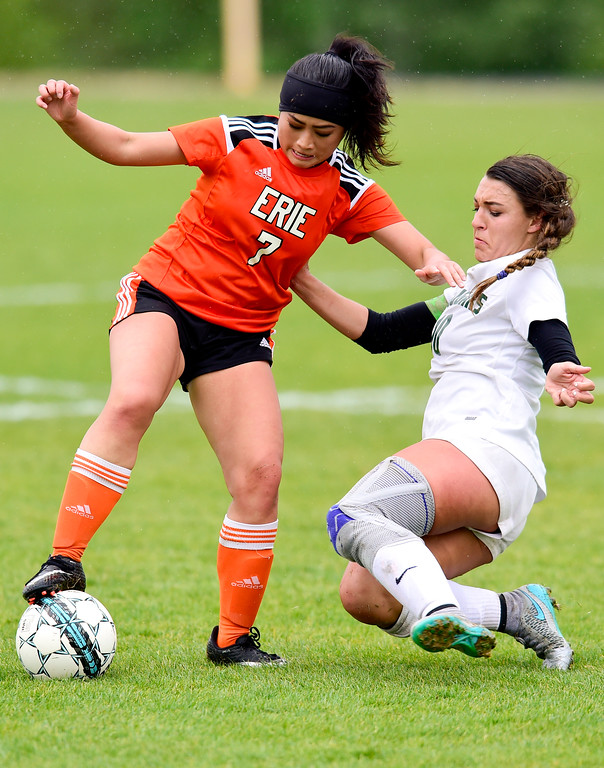 . Erie High School\'s Shuanah Xiong (No. 7) tries to maintain control of the ball while pressured by Niwot High School\'s Kailee Stobbe (No. 10) on Wednesday. More photos: BoCoPreps.com. Matthew Jonas/Staff Photographer May 10, 2017