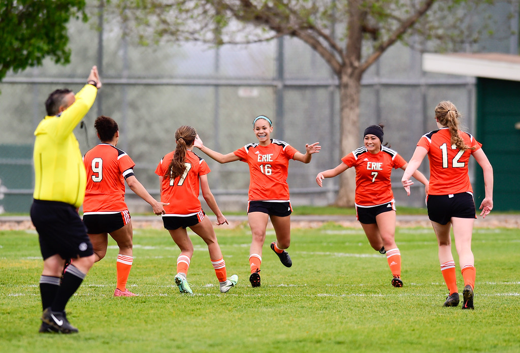 . Erie High School\'s Alison McNeal (No. 16) celebrates a goal with teammates against Niwot High School on Wednesday. More photos: BoCoPreps.com. Matthew Jonas/Staff Photographer May 10, 2017