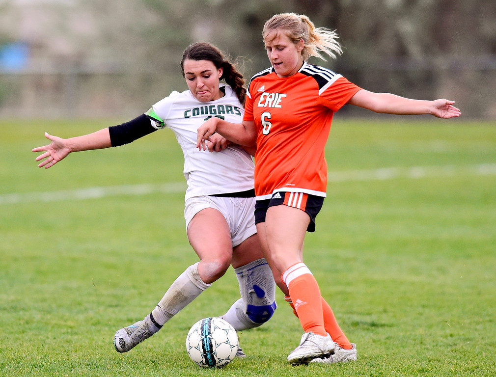 . Niwot High School\'s Kailee Stobbe (No. 10) and Erie High School\'s Maddie Foster (No. 6) collide while battling for the ball on Wednesday. More photos: BoCoPreps.com. Matthew Jonas/Staff Photographer May 10, 2017