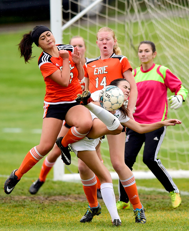 . Erie High School\'s Shuanah Xiong (No. 7) and Riane Sisk (No. 14) defend against a shot from Niwot High School\'s Charlotte McCarthy (No. 6) on Wednesday. More photos: BoCoPreps.com. Matthew Jonas/Staff Photographer May 10, 2017
