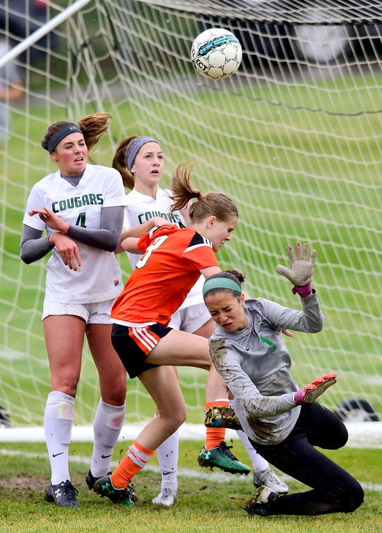 . Niwot High School\'s keeper Alexandra Colvin is shoved to the ground by Erie High School\'s Courtney Hull (No. 8) on Wednesday. More photos: BoCoPreps.com. Matthew Jonas/Staff Photographer May 10, 2017