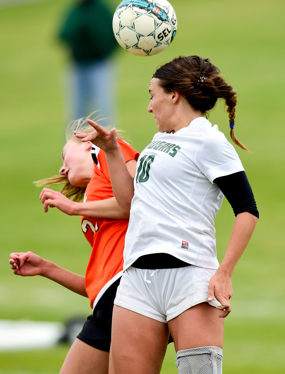 . Niwot High School\'s Kailee Stobbe (No. 10) and Erie High School\'s Adlee Schenbeck (No. 27) jump for the ball on Wednesday. More photos: BoCoPreps.com. Matthew Jonas/Staff Photographer May 10, 2017