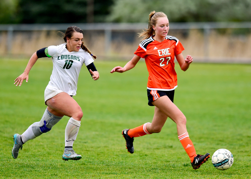 . Niwot High School\'s Kailee Stobbe (No. 10) and Erie High School\'s Adlee Schenbeck (No. 27) chase the ball on Wednesday. More photos: BoCoPreps.com. Matthew Jonas/Staff Photographer May 10, 2017
