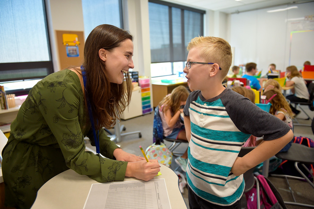 . ERIE, CO - AUG. 15: Fourth grader Bennett Knode meets his teacher Caroline Mersch-Watner at the front of the classroom on the first day of school at Soaring Heights PK-8, 3280 County Road 5, Wednesday morning, Aug. 15, 2018. The new school has about 960 students enrolled. To view more photos visit timescall.com. (Photo by Lewis Geyer/Staff Photographer)