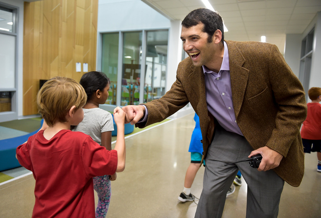 . Best3 ERIE, CO - AUG. 15: Principal Cyrus Weinberger greets second graders in the hallway on the first day of school at Soaring Heights PK-8, 3280 County Road 5, Wednesday morning, Aug. 15, 2018. The new school has about 960 students enrolled. To view more photos visit timescall.com. (Photo by Lewis Geyer/Staff Photographer)