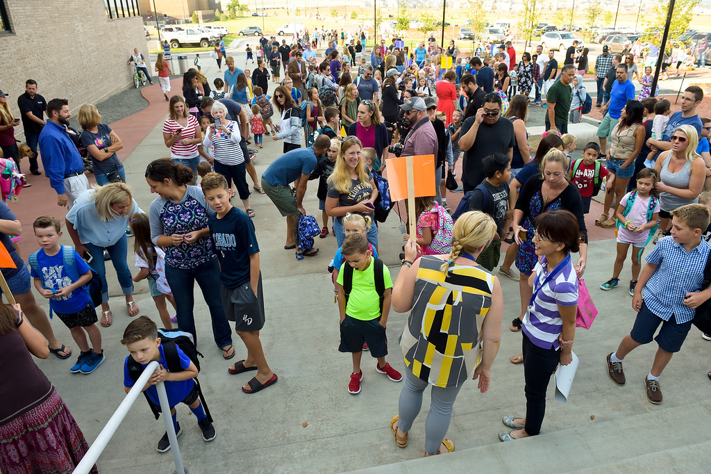 . ERIE, CO - AUG. 15: Parents, students, and staff gather at the entrance to Soaring Heights PK-8, 3280 County Road 5, on the first day of school Wednesday morning, Aug. 15, 2018. The new school has about 960 students enrolled. To view more photos visit timescall.com. (Photo by Lewis Geyer/Staff Photographer)
