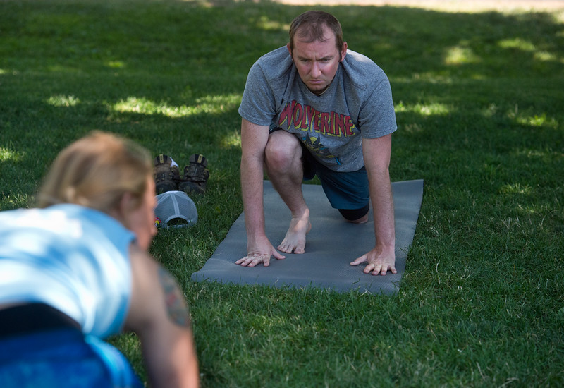 "Chris Hynes stretches during a yoga class led by Renee Rodgers (right) at Chautauqua Park on Thursday. <br /> More photos:  <a href=""http://www.dailycamera.com"">http://www.dailycamera.com</a><br /> (Autumn Parry/Staff Photographer)<br /> July 14, 2016"