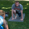 """Chris Hynes stretches during a yoga class led by Renee Rodgers (right) at Chautauqua Park on Thursday. <br /> More photos:  <a href=""""http://www.dailycamera.com"""">http://www.dailycamera.com</a><br /> (Autumn Parry/Staff Photographer)<br /> July 14, 2016"""