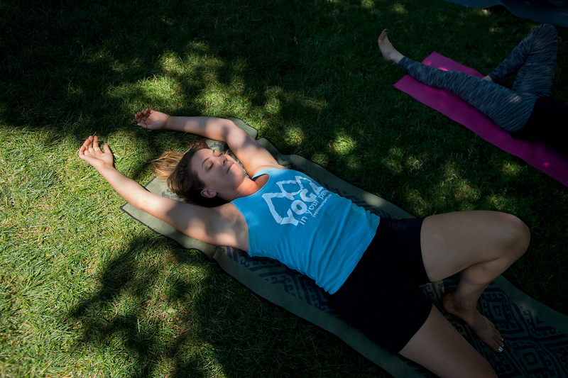"Ellen Sevigny, founder of Everest Healing Yoga, stretches during a yoga class led by Renee Rodgers at Chautauqua Park on Thursday. <br /> More photos:  <a href=""http://www.dailycamera.com"">http://www.dailycamera.com</a><br /> (Autumn Parry/Staff Photographer)<br /> July 14, 2016"
