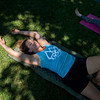 """Ellen Sevigny, founder of Everest Healing Yoga, stretches during a yoga class led by Renee Rodgers at Chautauqua Park on Thursday. <br /> More photos:  <a href=""""http://www.dailycamera.com"""">http://www.dailycamera.com</a><br /> (Autumn Parry/Staff Photographer)<br /> July 14, 2016"""
