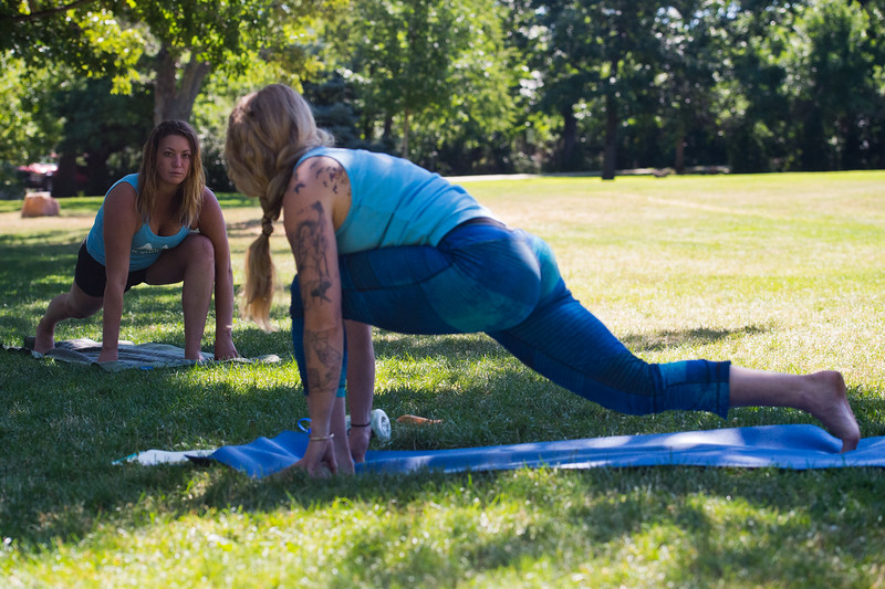 "Ellen Sevigny (left), founder of Everest Healing Yoga, stretches during a yoga class led by Renee Rodgers (right) at Chautauqua Park on Thursday. <br /> More photos:  <a href=""http://www.dailycamera.com"">http://www.dailycamera.com</a><br /> (Autumn Parry/Staff Photographer)<br /> July 14, 2016"