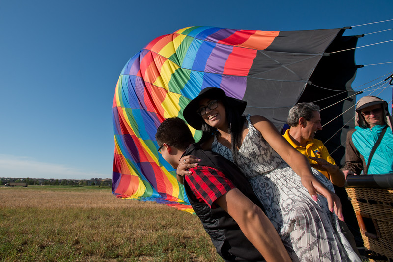 "Heber Salvador helps his girlfriend, Katherine Maradiaga, out of the air balloon basket after a ride by Fair Winds Hot Air Balloon Flights that left from Lafayette on Friday.<br /> More photos:  <a href=""http://www.dailycamera.com"">http://www.dailycamera.com</a><br /> (Autumn Parry/Staff Photographer)<br /> July 8, 2016"