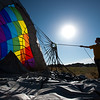 """Christina Longman, a crew member with Fair Winds Hot Air Balloon Flights, helps take down an air balloon after a morning launch from Lafayette on Friday.<br /> More photos:  <a href=""""http://www.dailycamera.com"""">http://www.dailycamera.com</a><br /> (Autumn Parry/Staff Photographer)<br /> July 8, 2016"""
