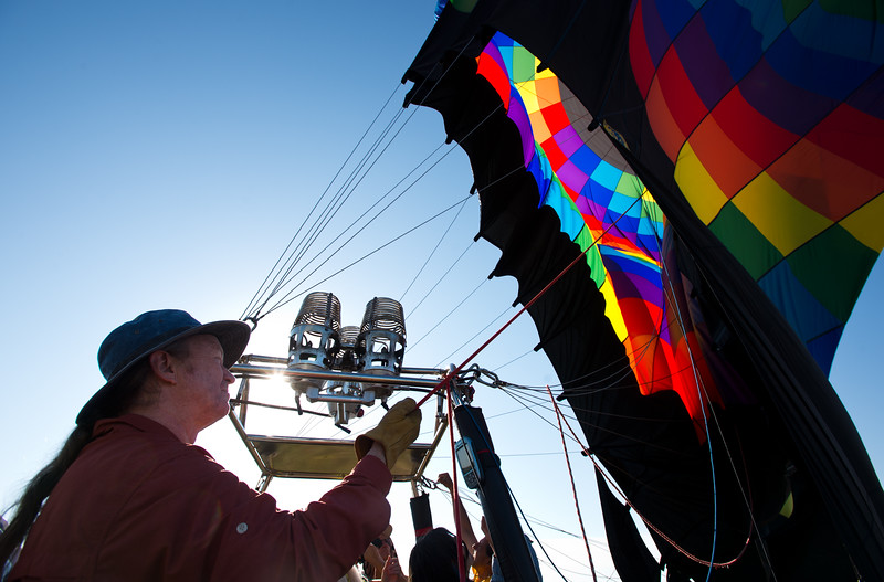 "Iain Court helps reel in an air balloon after a morning launch from Lafayette on Friday.<br /> More photos:  <a href=""http://www.dailycamera.com"">http://www.dailycamera.com</a><br /> (Autumn Parry/Staff Photographer)<br /> July 8, 2016"