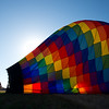 "Jeff Meeker, owner of Fair Winds Hot Air Balloon Flights, and his crew deflate a hot air balloon after a launch from Lafayette on Friday.<br /> More photos:  <a href=""http://www.dailycamera.com"">http://www.dailycamera.com</a><br /> (Autumn Parry/Staff Photographer)<br /> July 8, 2016"