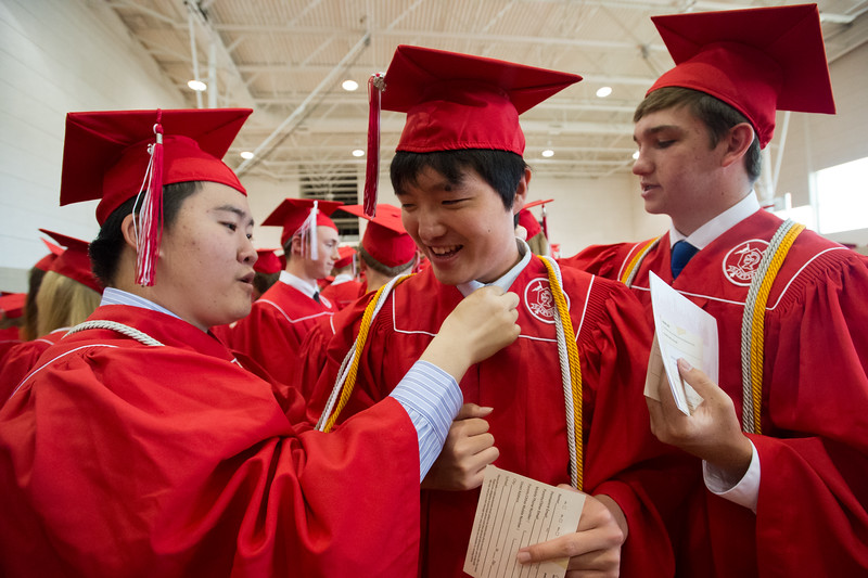 "Hongming Chen (left) and Samuel Chaim-Weismann (right) help Jackson Chen adjust his tassel prior to Fairview High School's commencement ceremony at 1st Bank Center in Broomfield on Sunday.<br /> More photos:  <a href=""http://www.dailycamera.com"">http://www.dailycamera.com</a><br /> Autumn Parry/Staff Photographer<br /> May 22, 2016"