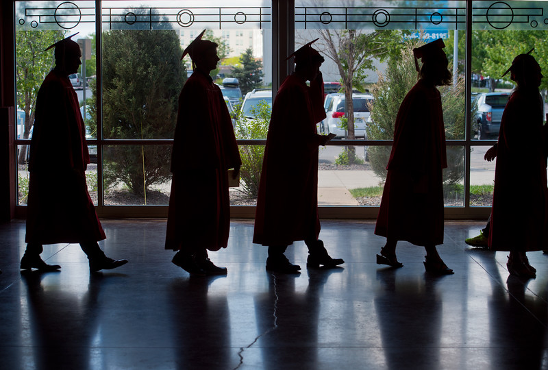 "Graduates line up for Fairview High School's commencement ceremony at 1st Bank Center in Broomfield on Sunday.<br /> More photos:  <a href=""http://www.dailycamera.com"">http://www.dailycamera.com</a><br /> Autumn Parry/Staff Photographer<br /> May 22, 2016"