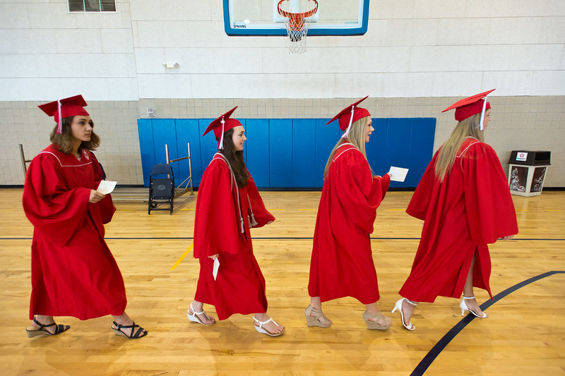 "Graduates head to the commencement ceremony for Fairview High School at 1st Bank Center in Broomfield on Sunday.<br /> More photos:  <a href=""http://www.dailycamera.com"">http://www.dailycamera.com</a><br /> Autumn Parry/Staff Photographer<br /> May 22, 2016"