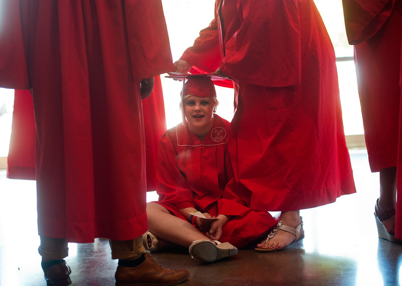 "Joanna Parker adjusts Carly Mocek cap prior to Fairview High School's commencement ceremony at 1st Bank Center in Broomfield on Sunday.<br /> More photos:  <a href=""http://www.dailycamera.com"">http://www.dailycamera.com</a><br /> Autumn Parry/Staff Photographer<br /> May 22, 2016"