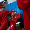 """Wyatt Dessel helps Olivia Kois adjust her tassel as they prepare for graduation prior to Fairview High School's commencement ceremony at 1st Bank Center in Broomfield on Sunday.<br /> More photos:  <a href=""""http://www.dailycamera.com"""">http://www.dailycamera.com</a><br /> Autumn Parry/Staff Photographer<br /> May 22, 2016"""