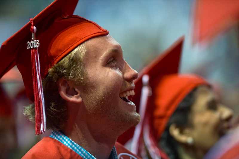 "Max Shaw laughs during a speech by Daniel Rahn during Fairview High School's commencement ceremony at 1st Bank Center in Broomfield on Sunday.<br />  More photos:  <a href=""http://www.dailycamera.com"">http://www.dailycamera.com</a><br /> Autumn Parry/Staff Photographer<br /> May 22, 2016"