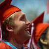 """Max Shaw laughs during a speech by Daniel Rahn during Fairview High School's commencement ceremony at 1st Bank Center in Broomfield on Sunday.<br />  More photos:  <a href=""""http://www.dailycamera.com"""">http://www.dailycamera.com</a><br /> Autumn Parry/Staff Photographer<br /> May 22, 2016"""