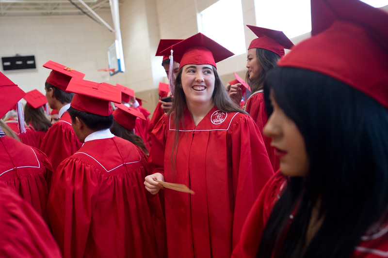 "Kathleen Burkepile lines up with fellow graduates prior to Fairview High School's commencement ceremony at 1st Bank Center in Broomfield on Sunday.<br /> More photos:  <a href=""http://www.dailycamera.com"">http://www.dailycamera.com</a><br /> Autumn Parry/Staff Photographer<br /> May 22, 2016"