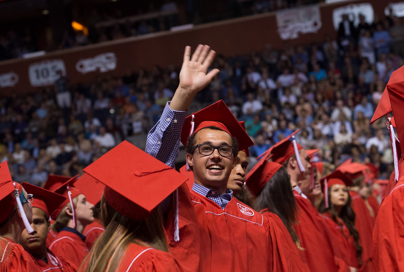 "Max Gelband waves to family and friends in the audience during Fairview High School's commencement ceremony at 1st Bank Center in Broomfield on Sunday.<br /> More photos:  <a href=""http://www.dailycamera.com"">http://www.dailycamera.com</a><br /> Autumn Parry/Staff Photographer<br /> May 22, 2016"