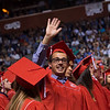 """Max Gelband waves to family and friends in the audience during Fairview High School's commencement ceremony at 1st Bank Center in Broomfield on Sunday.<br /> More photos:  <a href=""""http://www.dailycamera.com"""">http://www.dailycamera.com</a><br /> Autumn Parry/Staff Photographer<br /> May 22, 2016"""