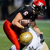 """Fairview's Tommy Wakefield is tackled by Mullen's Dedric Hood during the game at Boulder High School on Friday. <br /> More photos:  <a href=""""http://www.BoCoPreps.com"""">http://www.BoCoPreps.com</a><br /> (Autumn Parry/Staff Photographer)<br /> October 21, 2016"""