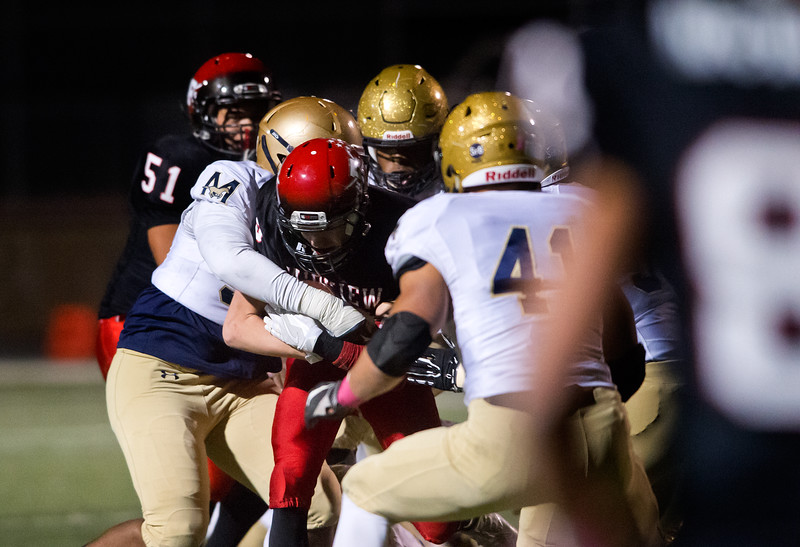 """A Fairview player is tackled by Mullen's defense during the game at Boulder High School on Friday. <br /> More photos:  <a href=""""http://www.BoCoPreps.com"""">http://www.BoCoPreps.com</a><br /> (Autumn Parry/Staff Photographer)<br /> October 21, 2016"""