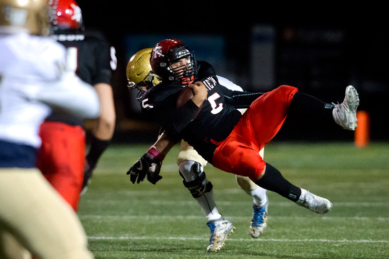 """Fairview's Mariano Kemp flips in the air as he is tackled by Mullen's defense during the game at Boulder High School on Friday. <br /> More photos:  <a href=""""http://www.BoCoPreps.com"""">http://www.BoCoPreps.com</a><br /> (Autumn Parry/Staff Photographer)<br /> October 21, 2016"""