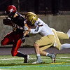"""Fairview's wide receiver Tommy Wakefield is tackled by Mullen's Dedric Hood during the game at Boulder High School on Friday. <br /> More photos:  <a href=""""http://www.BoCoPreps.com"""">http://www.BoCoPreps.com</a><br /> (Autumn Parry/Staff Photographer)<br /> October 21, 2016"""