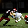 """Mullen's Wind Henderson is tackled by Fairview's Ashton Nichols (left) and Matt Greenwald (right) during the game at Boulder High School on Friday. <br /> More photos:  <a href=""""http://www.BoCoPreps.com"""">http://www.BoCoPreps.com</a><br /> (Autumn Parry/Staff Photographer)<br /> October 21, 2016"""