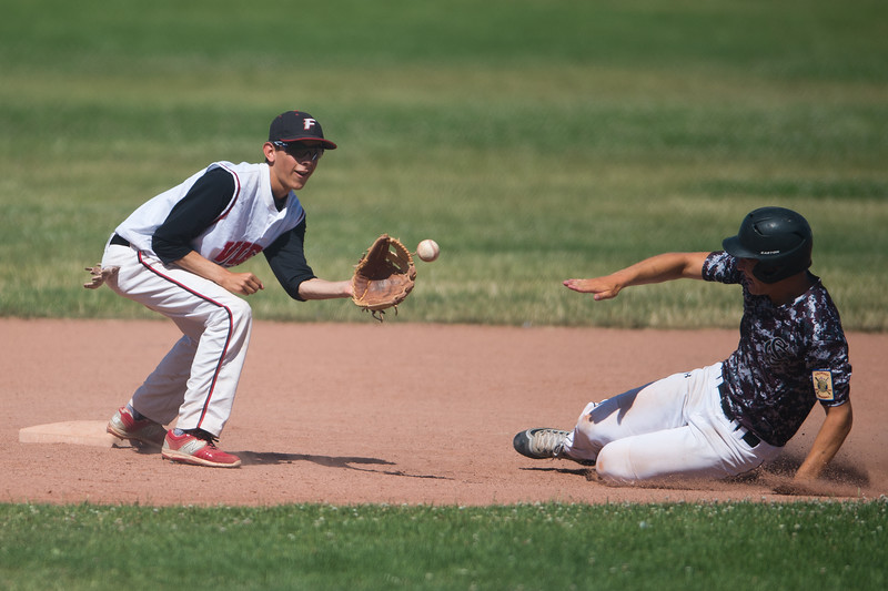 "Fairview's Johnny Garcia #8 catches the ball at second base before Silver Creek's #15 slides into safety during the game at Fairview High School on Thursday. <br /> More photos:  <a href=""http://www.BoCoPreps.com"">http://www.BoCoPreps.com</a><br /> (Autumn Parry/Staff Photographer)<br /> July 14, 2016"