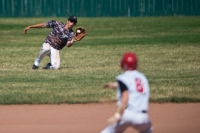 "Silver Creek's #48 drops the ball as Fairview's #8 runs back to first base during the game at Fairview High School on Thursday. <br /> More photos:  <a href=""http://www.BoCoPreps.com"">http://www.BoCoPreps.com</a><br /> (Autumn Parry/Staff Photographer)<br /> July 14, 2016"