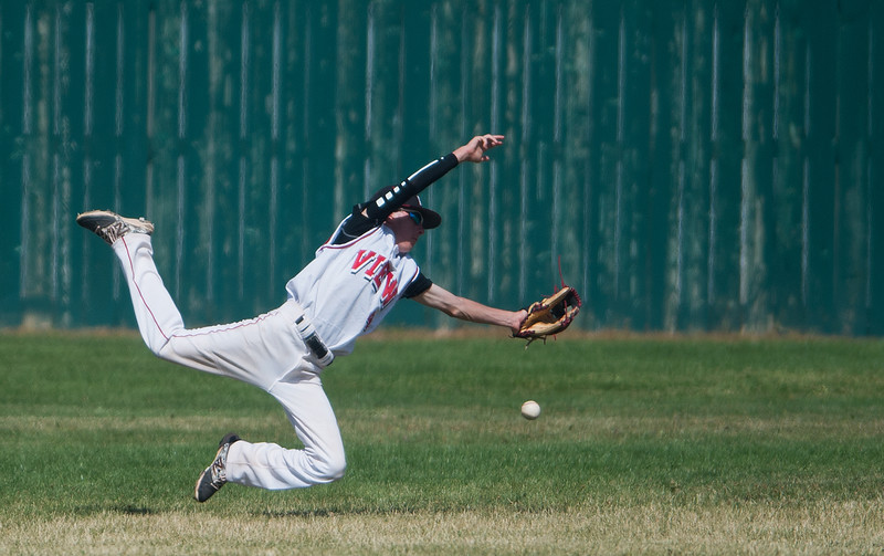 """Fairview's Logan McMinn #4 misses a catch in the outfield during the game against Silver Creek at Fairview High School on Thursday. <br /> More photos:  <a href=""""http://www.BoCoPreps.com"""">http://www.BoCoPreps.com</a><br /> (Autumn Parry/Staff Photographer)<br /> July 14, 2016"""