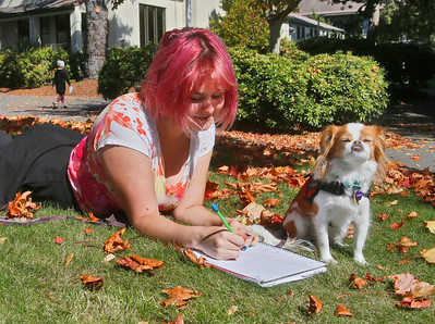 Psychology major Noelle Peterson and her Japanese chin dog Penny enjoy the sun amid fallen leaves near the Humboldt State University library on Tuesday. More sunshine is expected daily for at least the next week or so, though overnight low temperatures will be in the 40s. (Shaun Walker -- The Times-Standard)