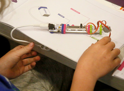 A girl creates an electronic project at Family Maker Night. (Shaun Walker -- The Times-Standard)