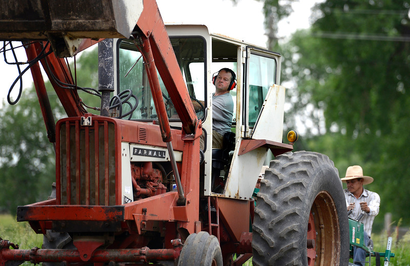 "Eric Skokan, of Black Cat Farm and Bistro drives a tractor along a field on Jay Road in Boulder on Monday morning. For more photos go to  <a href=""http://www.dailycamera.com"">http://www.dailycamera.com</a><br /> Devi Chung For The Camera. June 20, 2016"
