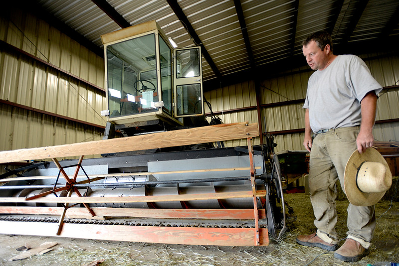 "Eric Skokan, of Black Cat Farm and Bistro examines his combine on Monday morning which he purchased from a farmer nearing retirement. For more photos go to  <a href=""http://www.dailycamera.com"">http://www.dailycamera.com</a><br /> Devi Chung For The Camera. June 20, 2016"