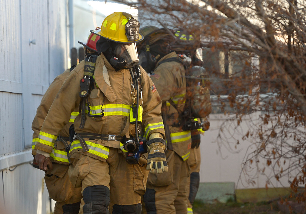 . LONGMONT, CO - NOVEMBER 9: Longmont firefighters prepare for a secondary search at the scene of a mobile home fire in the Weston Manor mobile home park, 729 17th Ave., Nov. 9, 2018. (Photo by Lewis Geyer/Staff Photographer)