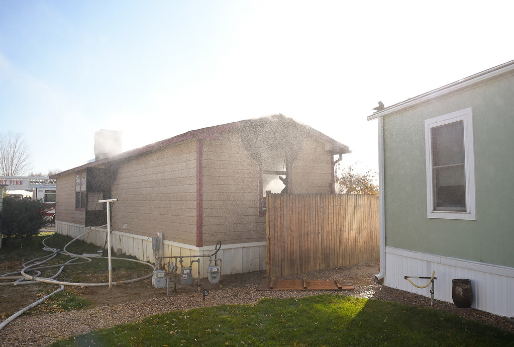 . LONGMONT, CO - NOVEMBER 9: Water is sprayed into the rear of a mobile home in the Weston Manor mobile home park, 729 17th Ave., Nov. 9, 2018. (Photo by Lewis Geyer/Staff Photographer)