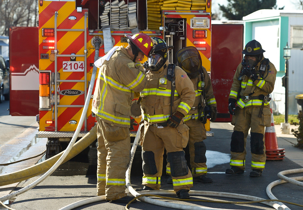 . LONGMONT, CO - NOVEMBER 9: Longmont firefighters at the scene of a mobile home fire in the Weston Manor mobile home park, 729 17th Ave., Nov. 9, 2018. (Photo by Lewis Geyer/Staff Photographer)