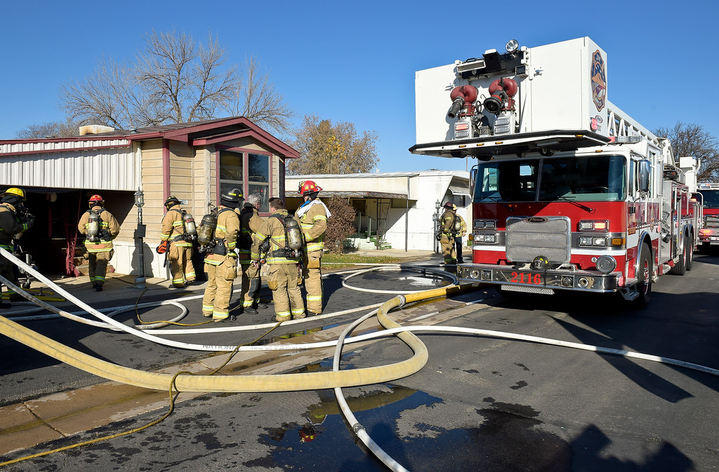 . LONGMONT, CO - NOVEMBER 9: Firefighting equipment fill the street at the scene of a mobile home fire in the Weston Manor mobile home park, 729 17th Ave., Nov. 9, 2018. (Photo by Lewis Geyer/Staff Photographer)