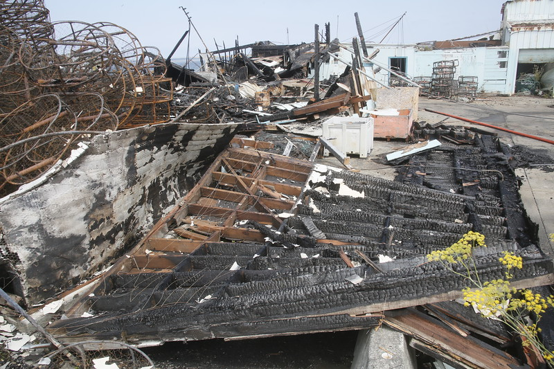 Shaun Walker — The Times-Standard  A large warehouse structure on the Olsen Dock in Fields Landing was destroyed by a fire Tuesday night. The fire is considered to be suspicious and human caused.