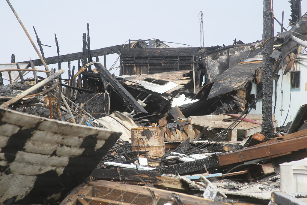 . Shaun Walker � The Times-Standard  A large warehouse structure on the Olsen Dock in Fields Landing was destroyed by a fire Tuesday night. The fire is considered to be suspicious and human caused.