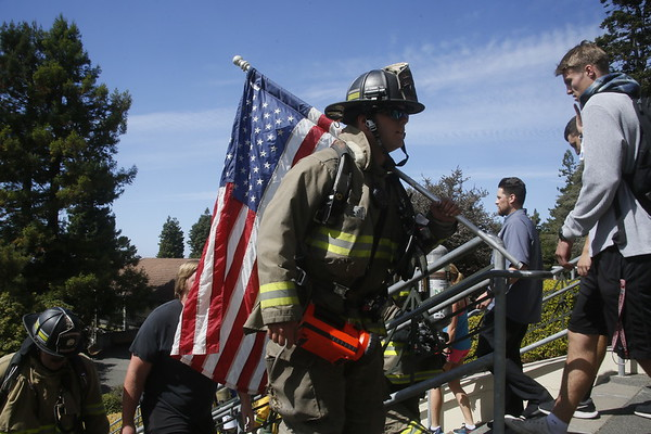 Photos: Firefighters climb steps in memory of 9/11 fallen colleagues