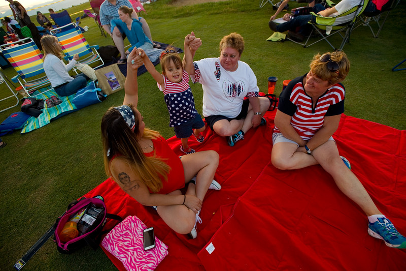 "From left to right, Cassandra Lovato, Kamilla Lovato, 1, Cindy Armenta and Geneva Ferrera wait for the fireworks  to begin during the July 3rd Extravaganza at the Colorado National Golf Club in Erie on Sunday. <br /> More photos:  <a href=""http://www.dailycamera.com"">http://www.dailycamera.com</a><br /> (Autumn Parry/Staff Photographer)<br /> July 3, 2016"